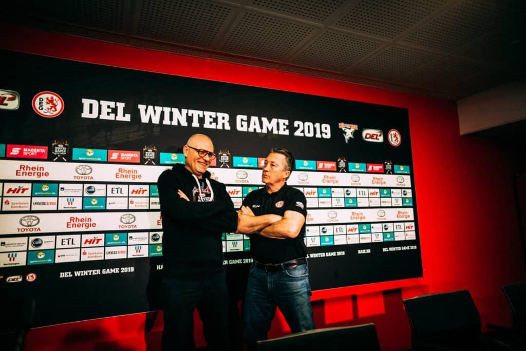 Haie-Trainer Peter Draisaitl und DEG-Trainer Harold Kreis beim DEL WINTERGAME 2019. Foto: Basti Sevastos.